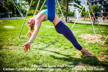 1. Layback in the Cross Position - Aerial Yoga Is It Right For You