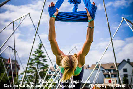 3. Shoulder Stretch in Wrist Wrap - Aerial Yoga Is It Right For You