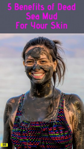 Woman covered in mud at the dead sea