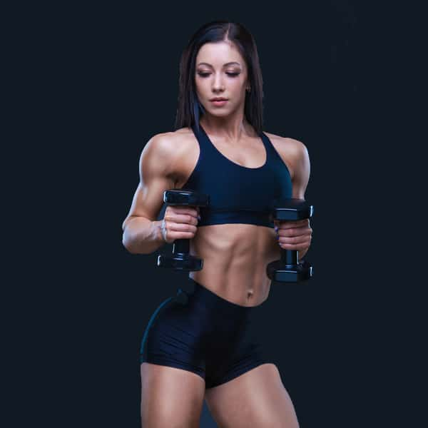 female body-builder holding 2 dumbbells