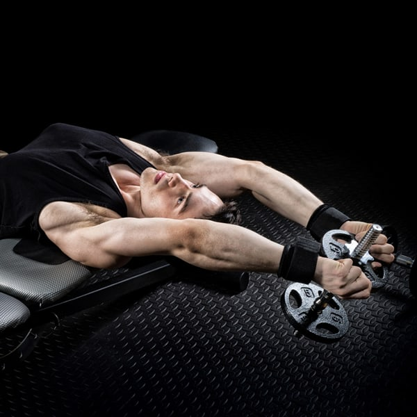 athletic male exercising with dumbbells