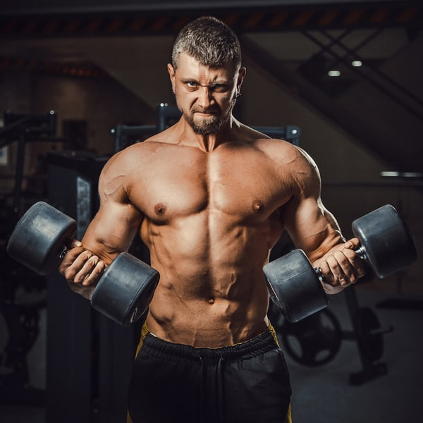 Male Bodybuilder Holding Dumbells