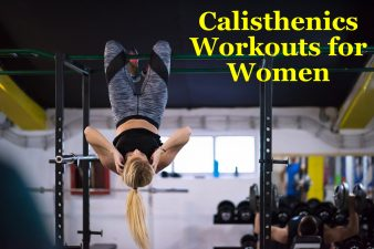 Athletic woman doing calisthenics workouts hanging upside down on horizontal bar at fitness gym